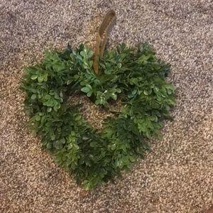 Fake plant, hanging heart.